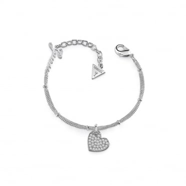 Rhodium plated bracelet features three thin chains linked by metal dots and a Swarovski® pavè heart charm.