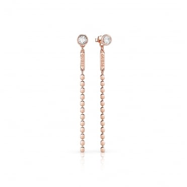Rose gold plated earrings feature a frontal Swarovski® crystal stud with a back closure made of a flat Guess logo plaque.